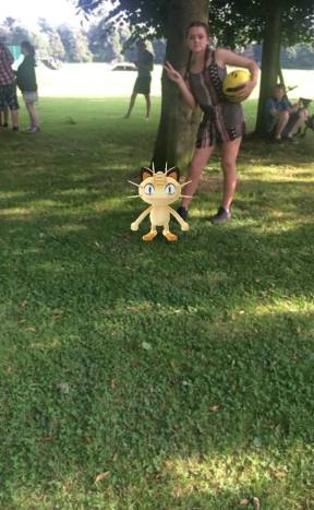 Shannon poses with Meowth!